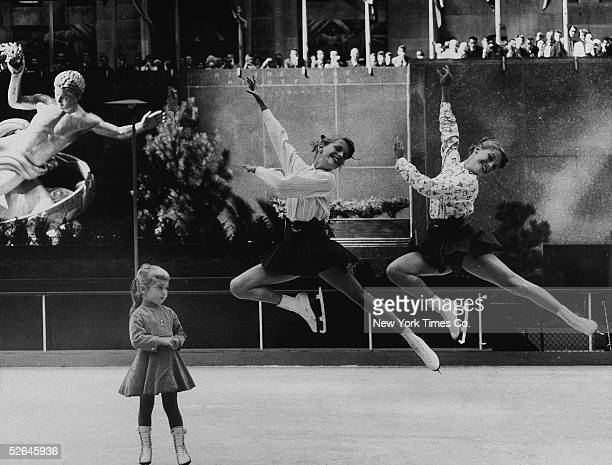 American figure skater Carol Heiss and her younger sister Nancy Heiss practice syncronized jumps on the ice rink at Rockefeller Center while 4yearold...