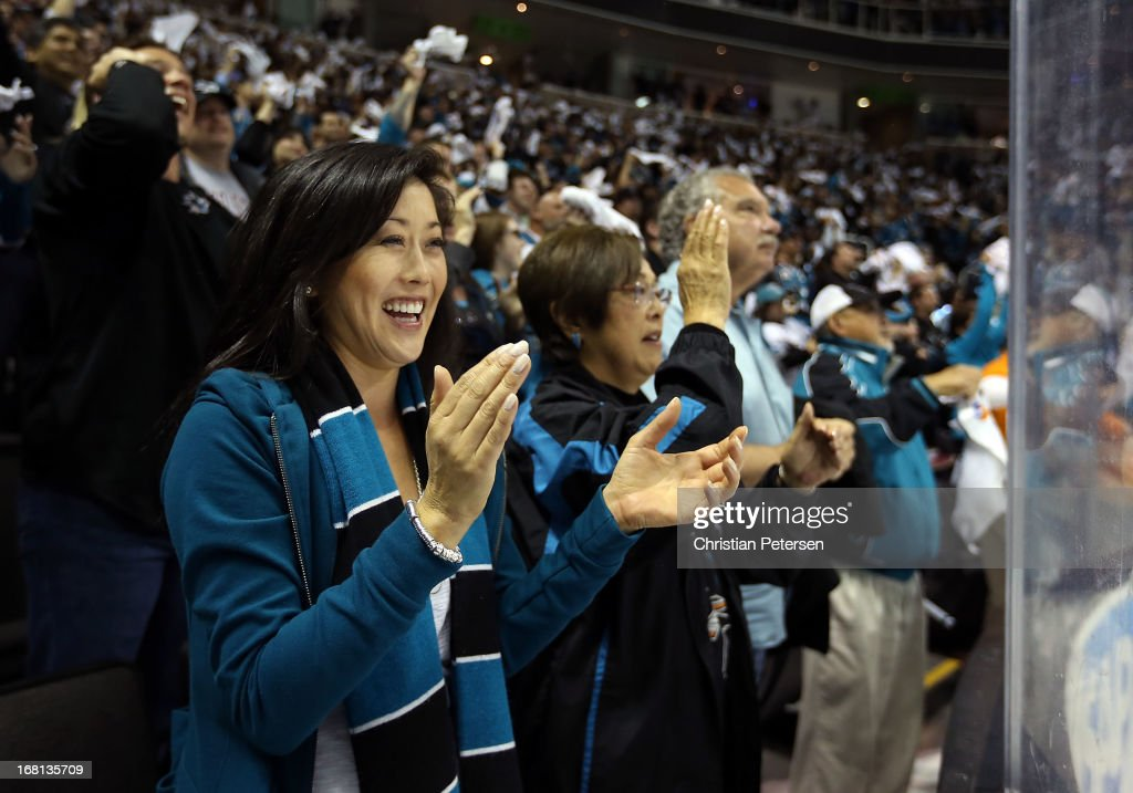 American figure skater, <a gi-track='captionPersonalityLinkClicked' href=/galleries/search?phrase=Kristi+Yamaguchi&family=editorial&specificpeople=234361 ng-click='$event.stopPropagation()'>Kristi Yamaguchi</a> applauds after the San Jose Sharks scored a third-period goal against the Vancouver Canucks in Game Three of the Western Conference Quarterfinals during the 2013 NHL Stanley Cup Playoffs at HP Pavilion on May 5, 2013 in San Jose, California. The Sharks defeated the Canucks 5-2.
