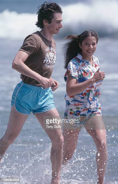 American figure skating duo Randy Gardner and Tai Babilonia running along a beach May 1979