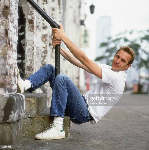 American film actor Kevin Costner in white Tshirt and denims circa 1990
