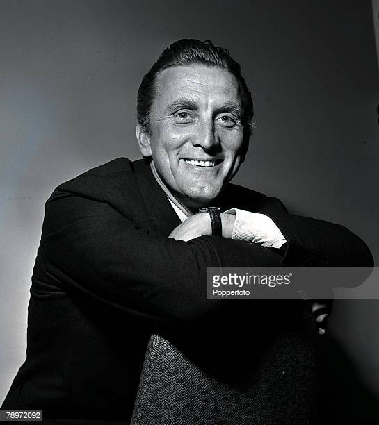 American film actor Kirk Douglas poses for a portrait at the Savoy Hotel in London 1957