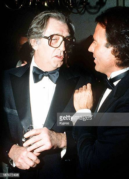 American film actor Robert Mitchum with singer Julio Iglesias circa 1990