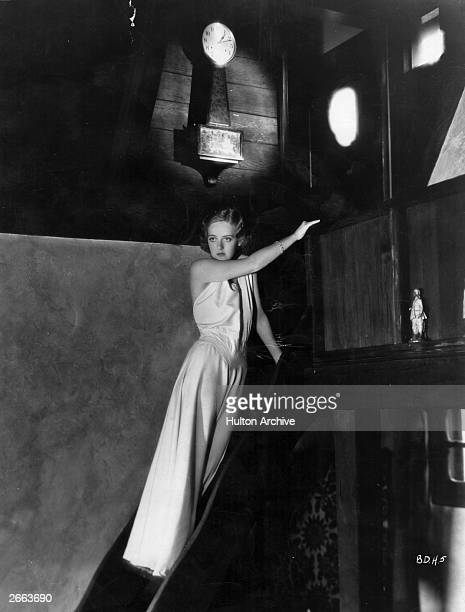 American film actress Bette Davis inside her Hollywood home a unique hillside bungalow