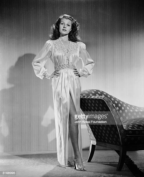American film actress dancer and singer Rita Hayworth wearing a silk negligee and high heels for her role of Sally Elliott in the film 'My Girl Sal'...