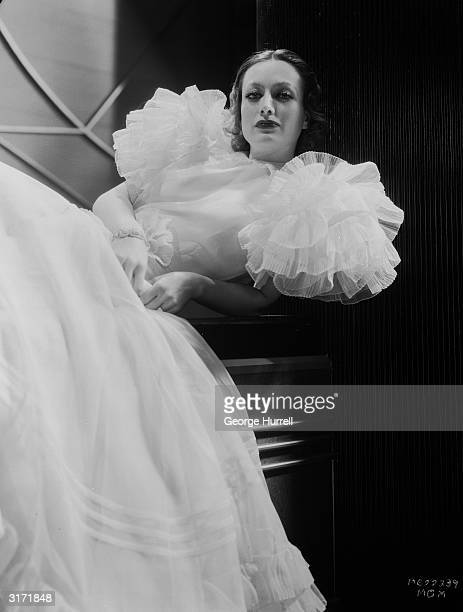 American film actress Joan Crawford plays the title role in film director Clarence Brown's drama 'Letty Lynton' Her white organdie dress was designed...