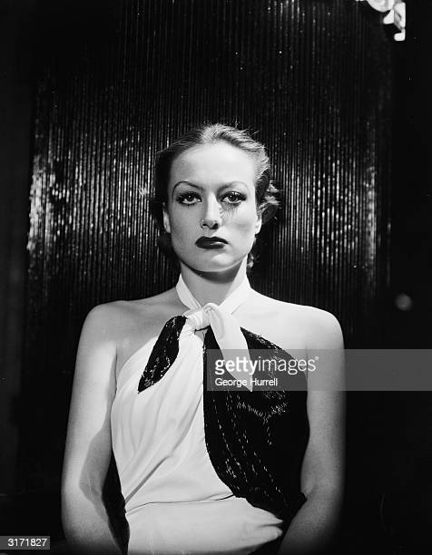 American film actress Joan Crawford plays the title role in 'Letty Lynton' directed by Clarence Brown She wears a dress designed by Adrian