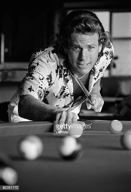 American film and television actor Ryan O'Neal playing pool at his home in California in October 1974