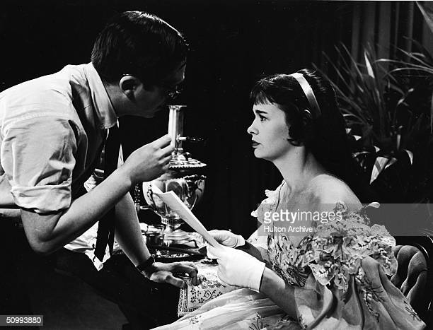 American film and television director Sidney Lumet offers pointers to his wife heiress and actress Gloria Vanderbilt while the pair are on the set of...