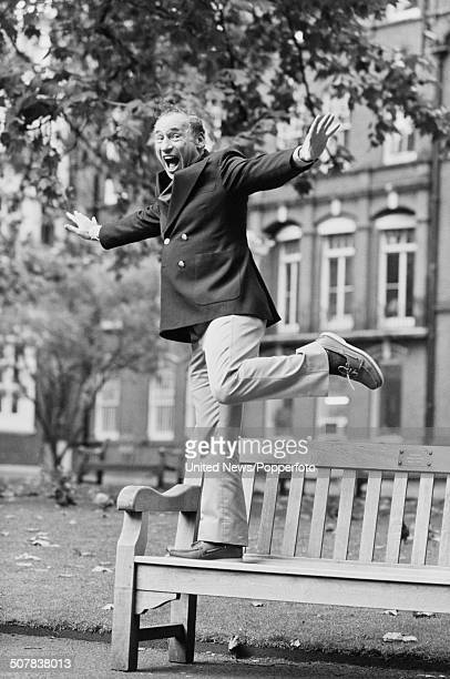 American film director and actor Mel Brooks posed standing on one leg on a park bench in London to promote his film 'History of the World Part I' on...