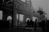 American film director and actor Woody Allen and actress Diane Keaton sit under the Queensboro Bridge in a scene from Allen's movie 'Manhattan' New...