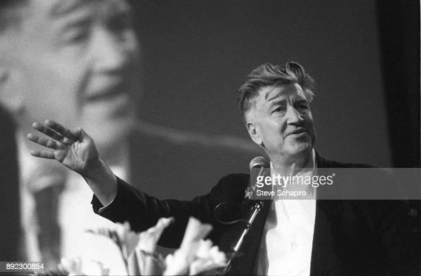 American film director David Lynch gestures as he speaks at a microphone Iowa 2005