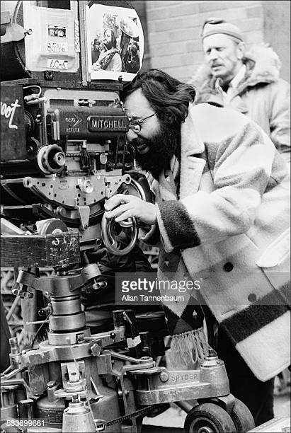American film director Francis Ford Coppola looks through the camera on the East Village set of his film 'The Godfather Part II' New York New York...