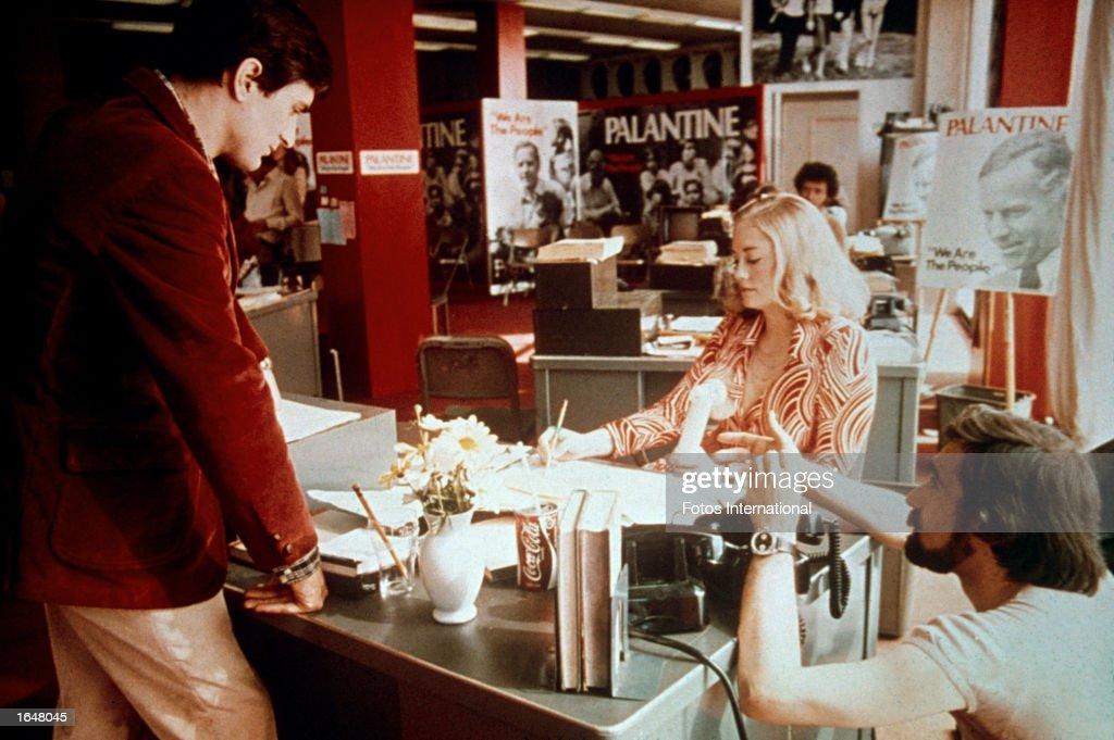 American film director Martin Scorsese crouches while directing American actors Robert De Niro and Cybill Shepard inside a politician's campaign...