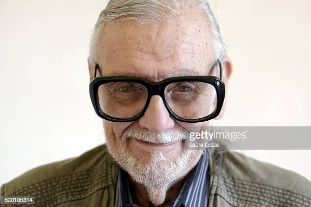 American film Director screen writer and editor George Romero poses for a photo after attending a press conference during the Lucca Film Festival...