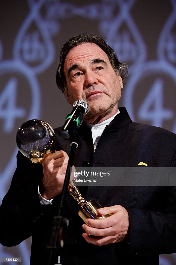 American film director, screenwriter, producer <a gi-track='captionPersonalityLinkClicked' href=/galleries/search?phrase=Oliver+Stone&family=editorial&specificpeople=173458 ng-click='$event.stopPropagation()'>Oliver Stone</a> holds the Crystal Globe for Outstanding Artistic Contribution to World Cinema as he becomes Globe at the closing ceremony of the 48th Karlovy Vary International Film Festival (KVIFF) on July 06, 2013 in Karlovy Vary, Czech Republic.