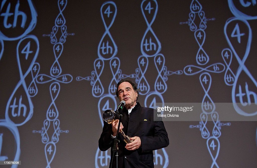 American film director, screenwriter, producer <a gi-track='captionPersonalityLinkClicked' href=/galleries/search?phrase=Oliver+Stone&family=editorial&specificpeople=173458 ng-click='$event.stopPropagation()'>Oliver Stone</a> holds the Crystal Globe for Outstanding Artistic Contribution to World Cinema at the closing ceremony of the 48th Karlovy Vary International Film Festival (KVIFF) on July 06, 2013 in Karlovy Vary, Czech Republic.