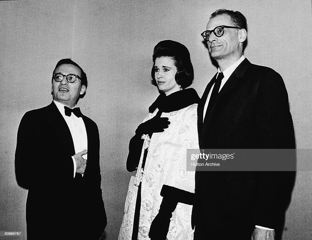 American film director <a gi-track='captionPersonalityLinkClicked' href=/galleries/search?phrase=Sidney+Lumet&family=editorial&specificpeople=214143 ng-click='$event.stopPropagation()'>Sidney Lumet</a> stands with hand inside his tuxedo jacket pocket next to his second wife American heiress and designer <a gi-track='captionPersonalityLinkClicked' href=/galleries/search?phrase=Gloria+Vanderbilt+-+Fashion+Designer&family=editorial&specificpeople=214786 ng-click='$event.stopPropagation()'>Gloria Vanderbilt</a>, and American playwright <a gi-track='captionPersonalityLinkClicked' href=/galleries/search?phrase=Arthur+Miller&family=editorial&specificpeople=93098 ng-click='$event.stopPropagation()'>Arthur Miller</a>, early 1960s.