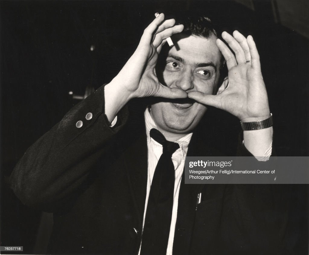 American film director Stanley Kubrick (1928 - 1999) holds his hands to around his face, a cigarette between his fingers, on the set of his film 'Dr. Strangelove, Or How I Learned to Stop Worrying and Love the Bomb' (1964), England, early 1963. (Photo by Weegee(Arthur Fellig)/International Center of Photography/Getty Images)