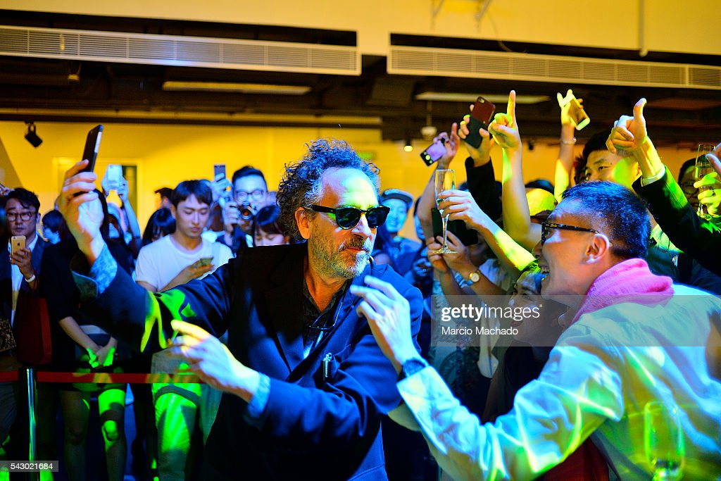 American Film Director Tim Burton taking some selfies with fans during the launch of his creative production The World of Tim Burton on June 25, 2016 in Shanghai, China.