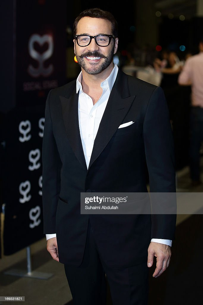 American film producer and actor, Jeremy Samuel Piven pose for photographers on the red carpet during the Social Star Awards 2013 at Marina Bay Sands on May 23, 2013 in Singapore.