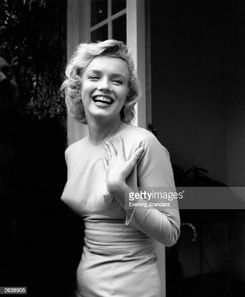 American film star Marilyn Monroe outside her home at Englefield Green