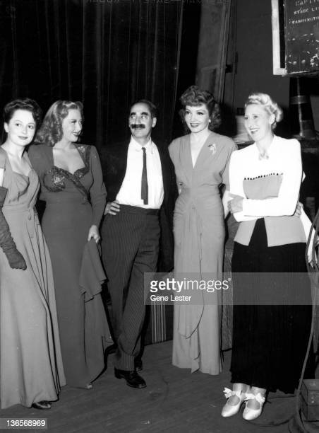 American film stars on tour with the Hollywood Victory Caravan USA 16th May 1942 Left to right Olivia de Havilland Joan Blondell Groucho Marx...