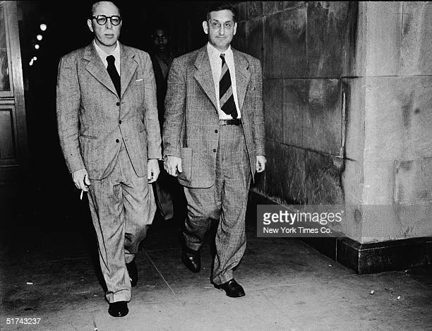 American film writers John Howard Lawson and Dalton Trumbo leave a federal court hadcuffed together to begin serving one year contempt of court...