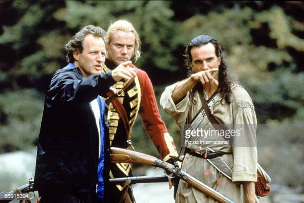 American filsm director Michael Mann points into the distance as he rehearses a scene with British actors Steven Waddington and Daniel DayLewis...
