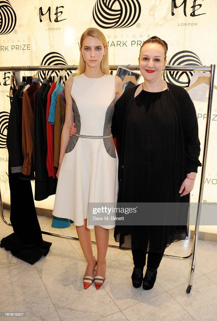American finalist Sophie Theallet (R) and a model wearing her designs attend the 2013 International Woolmark Prize Final at ME London on February 16, 2013 in London, England.