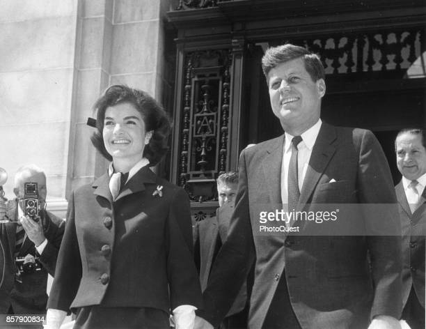 American First Lady Jacqueline Kennedy and politician US President John F Kennedy as they hold hands while they leave the Pan American Union Building...