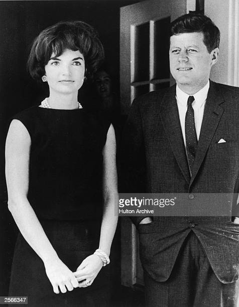 American First Lady Jacqueline Kennedy stands with her husband President John F Kennedy in the door of the White House Washington DC circa 1961