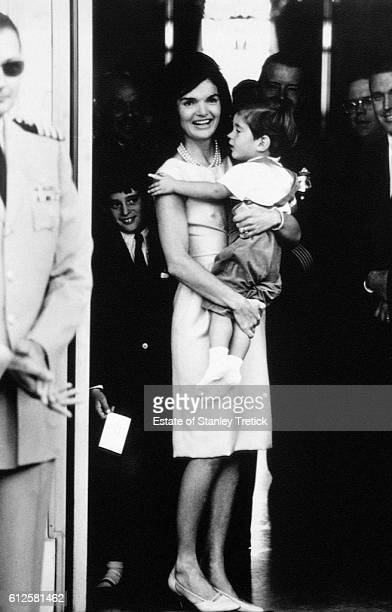 American First Lady Jacqueline Lee 'Jackie' Bouvier Kennedy holding her son John Jr at the White House North Portico May 24 1963