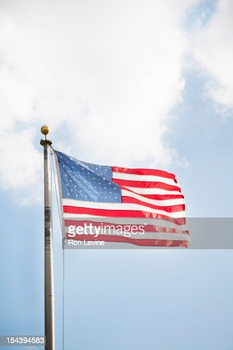 American flag against a blue sky : Stock Photo