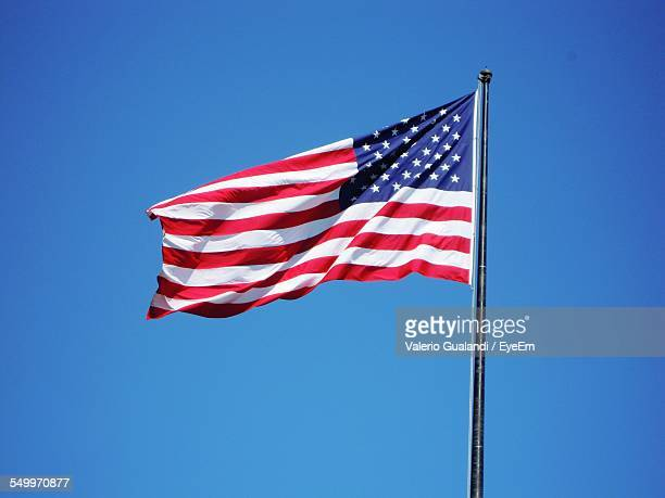 American Flag Against Clear Blue Sky
