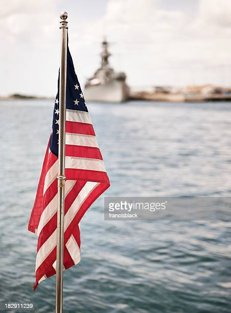 American flag and military ship