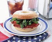 American flag beneath bagel on plate