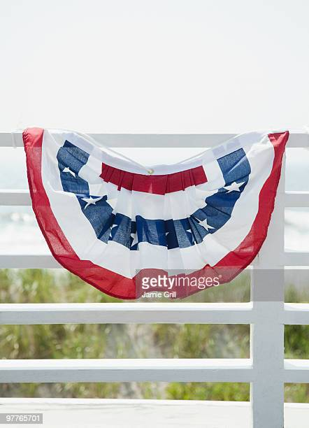 American flag decoration on fence