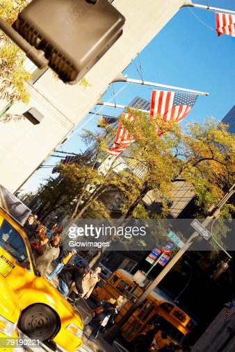 American flag fluttering on a building, Fifth Avenue, Manhattan, New York City, New York State, USA : Stock Photo