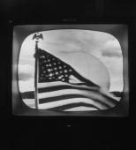 American flag flying in front of Telstar ground relay station as seen on broadcast via satellite