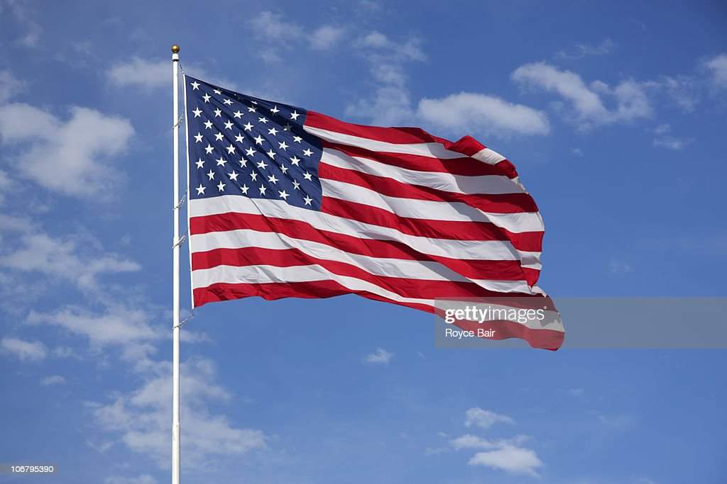 American flag flying in the wind : Stock Photo