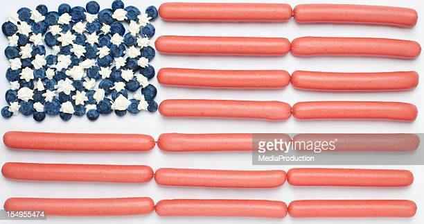 American flag from blue berries cream and hotdogs