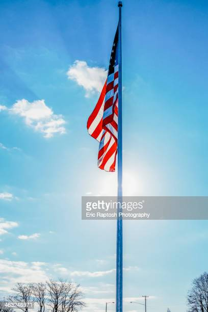 American flag hanging from flagpole outdoors
