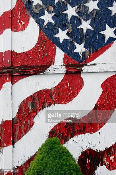 American flag painted on peeling door Vinalhaven Island Maine New England USA