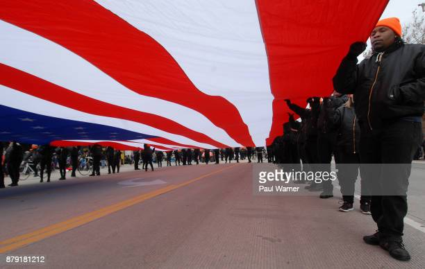 American flag sponsored by watchmaker Shinola is marched down Woodward Ave on November 23 2017 in Detroit Michigan during the 91st America's...