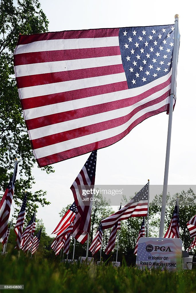 American flags are displayed near the eighth hole in remembrance of fallen soldiers during the first round 2016 Senior PGA Championship presented by KitchenAid at the Golf Club at Harbor Shores on May 26, 2016 in Benton Harbor, Michigan.