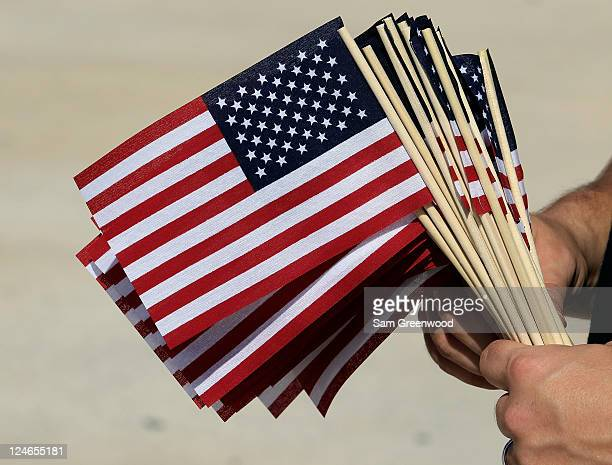 American flags are handed out prior to a game between the Jacksonville Jaguars and Tennessee Titans at EverBank Field on September 11 2011 in...