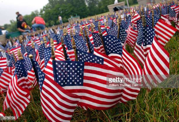 American flags are placed in the ground as part of the Donald W Jones Flag Memorial June 13 2003 in Fairless Hills Pennsylvania Sixty thousand flags...