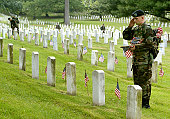 American Flags Are Placed On Gravestones In Arlington To Honor War Dead
