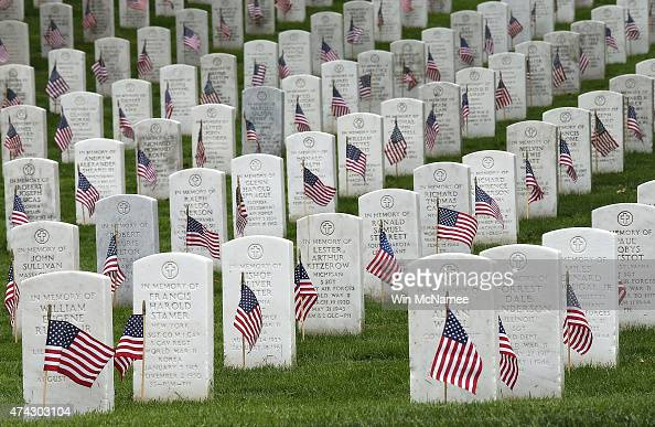 American flags are shown after being placed by members of the 3rd US Infantry Regiment at the graves of US soldiers buried at Arlington National...