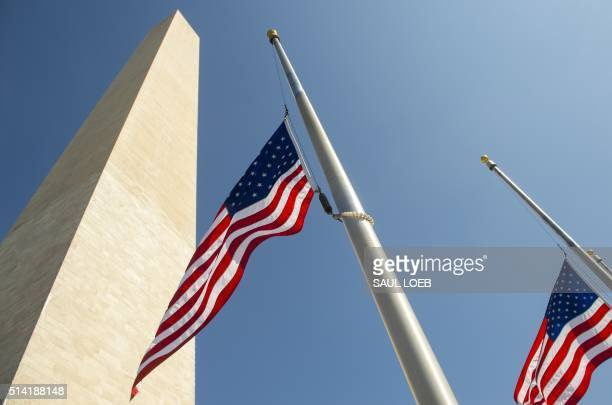 American flags fly at halfstaff around the base of the Washington Monumenton the Mall near the US Capitol in Washington DC March 7 in honor of former...